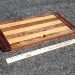 This is a teak and holly cutting board that goes over the top of the stove.  I had only the finish dimensions of my Origo 6000 but I figured for $5 it is worth a try.