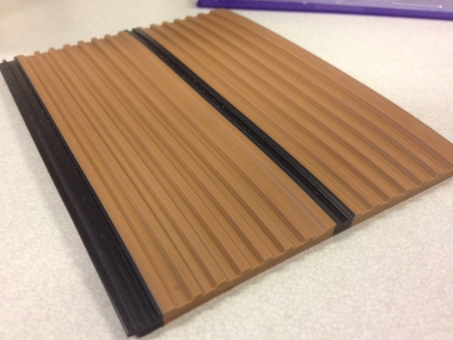 The underside of the panel strip has some ridges for resilience and better adhesion